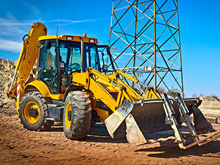 Backhoe operating in a site